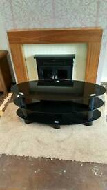 Black glass oval 3 tier TV stand
