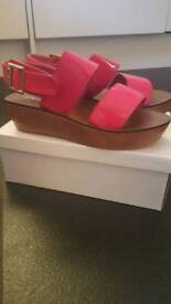 Brand new pink wedges. Size 6.
