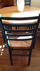 Modern kitchen/dining room table with 4 chairs. Good condition.