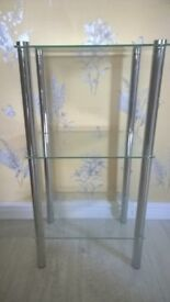 Glass shelf unit with chrome legs in exc cond Glass is tempered glass
