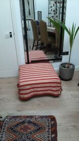 Pouffe padded with interchangeable covers