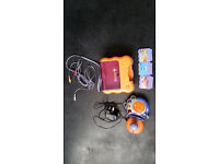 V-tech smile console. Including 3 games .adaptor and control pad.