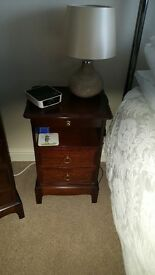A stag minstrel tall and narrow bedside cabinet in excellent condition