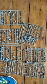 Assortment of unpainted Warhammer (Empire, Lizardmen, Orcs, Gondor, Uruk Kai)