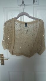 Next ladies shrug. gold knitted with sequin detail. s/m