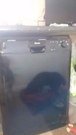 Black dishwasher in a good condition.
