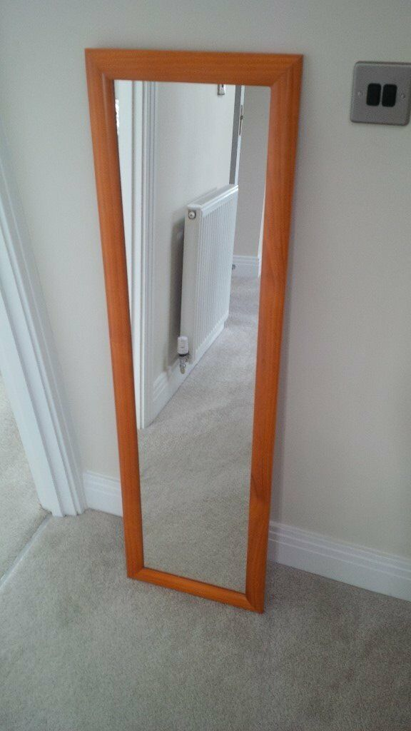 Mirror (either free standing or on wall/wardrobein Mill Hill, LondonGumtree - Mirror with wooden frame. It can be used free standing or attached to wall, or used inside the door of a wardrobe Measurements 120cm x 35cm