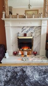 White fireplace with electric fire