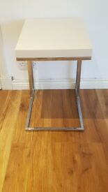 * high gloss white and chrome side table*