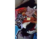 Big bundle of women's clothes alot with tags on