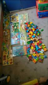 Wooden puzzles and blocks/bricks