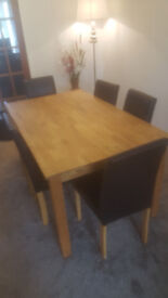 solid oak dining table and 5 chairs
