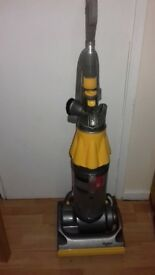Yellow dyson dc07 hoover