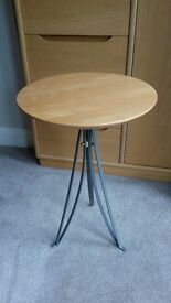 Round side table. Wooden top with metal legs. 60cm Height 39cm Diameter top.
