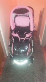 pink and black 3 in 1 reversable pram