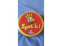Spot It! Speed matching card game. Comes with all cards and instructions.