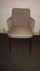 Grey arm chair.