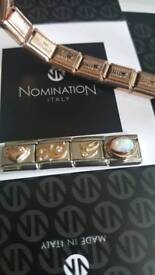 Brand new Rose gold nomination bracelet and charms