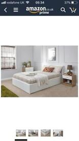 White leather king size gas lift ottoman bed