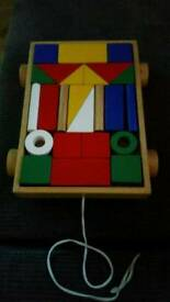 Wooden blocks and shapes on wheels