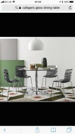 Callagaris planet glass dining table and 4 chairs.