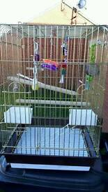 Brand new birdcage with toys attached excellent condition