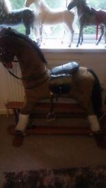 Large gliding rocking horse