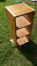 Spinning storage shelf unit book shelf