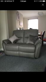 Brand new new grey leather sofa 2 seater