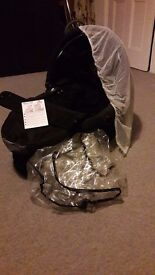 Quinny dreami cot with raincover and flynet.good as brand new.To fit with Quinny buggy