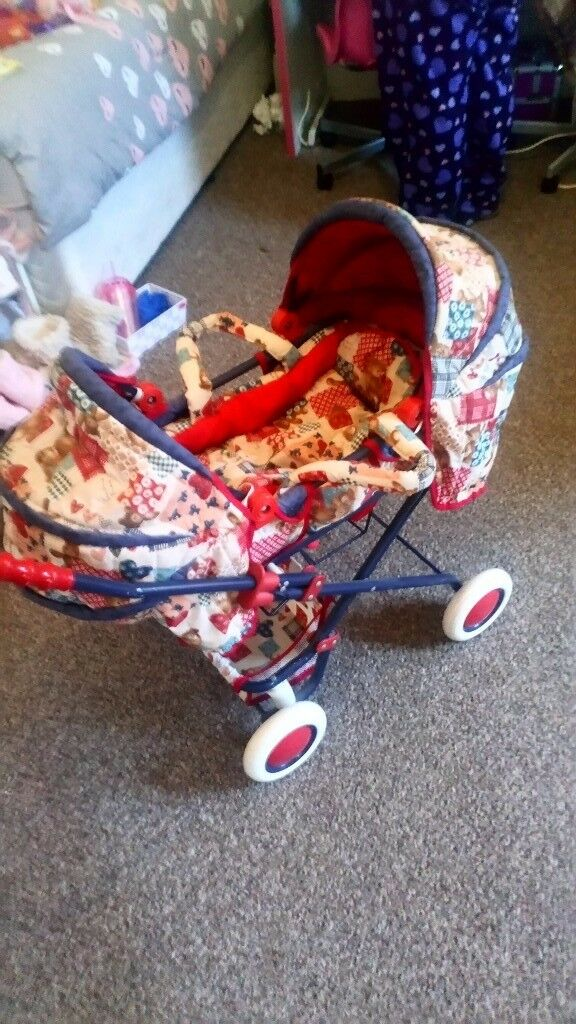 Dolls double pram excellent condition with shopping basket ideal for a gift from a smoke free home
