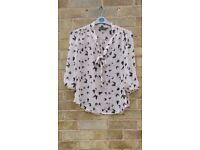 Pink and black butterfly print blouse