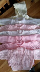 7 knitted baby girls cardigans