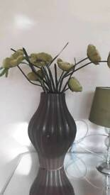 Large brown vase from germany with flowers
