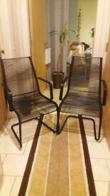 2 black metal chairs