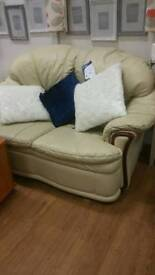 2 seat cream leather sofa.. few cat scratches on the back