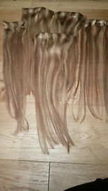 100% REMY CLIP-IN EXTENSIONS