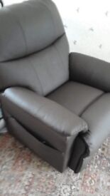 Brand new brown leather remote riser chair,never used cost £1600 new will accept £900 ovno