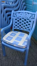 Blue Plastic Stackable Chairs with cushions