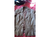 Soft brown leather marks and spencer jacket .