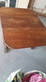 Dropping leaf oak dining table