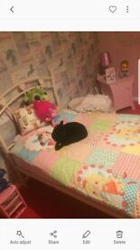 Pink single bed and matteress