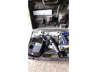 Cordless hammer drill with extra power pack plus mini sander and jigsaw