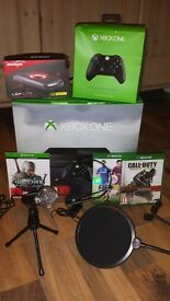 Xbox One with games, 2 controllers, official headset and game recording equipment (optional).