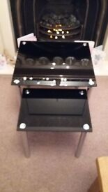 Nest of Two Black Glass and Chrome Coffee tables.