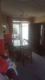 6 seater extending dining table and 6 chairs with matching display cabinet