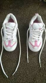Heelys size 2 x 2 pairs (black /red and white /pink) in good condition
