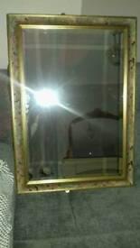 Floral framed rectangular bevelled edge mirror.