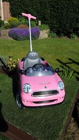 Childs push and steer mini cooper in pink