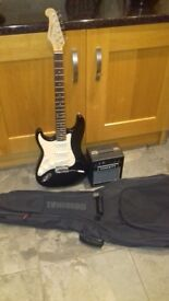 Left Handed Tanglewood Electric Guitar with Amplifier and gig bag for sale.